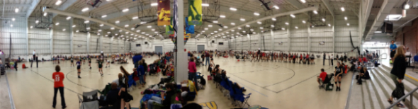 "alt=""Panoramic view of the Discovery Sports Center during volleyball tournament"""